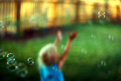 Unfocused image of boy and bubbles
