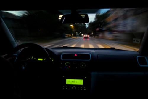 a-shotgun-camera-tripod-mounting-a-camera-next-to-the-drivers-sit