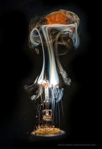Photographs Of Smoke From Burnt Light Bulbs Hitting Glass