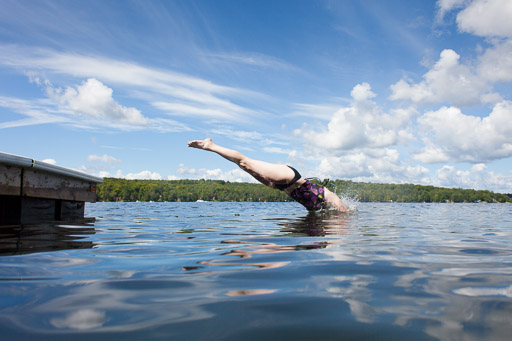 woman diving into lake
