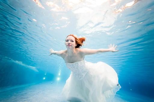Woman swimmin in pool underwater