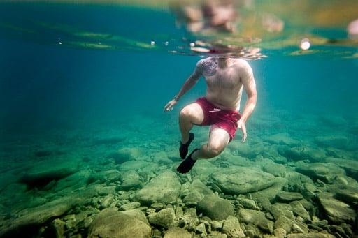 Man treading water underwater