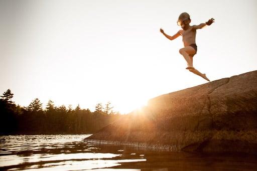 little boy jumping into lake in muskoka jp danko toronto commercial photographer