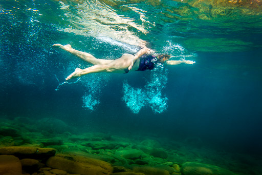 Woman swimming freestyle underwater