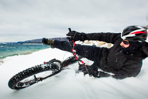 winter mountain biking wipeout man falling off fat bike in the snow in winter jp danko toronto commercial photographer blurmedia