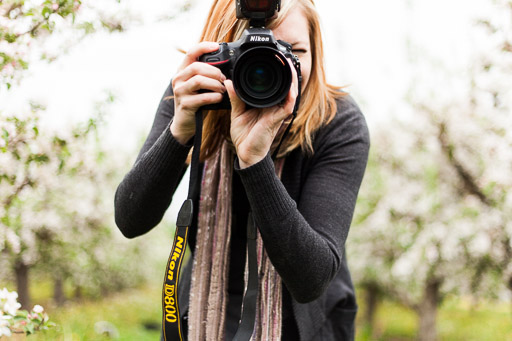 woman taking photos up close jp danko toronto commercial photographer