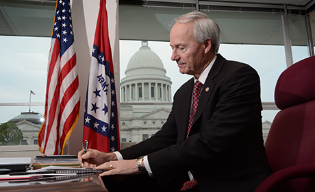 Governor Hutchinson signing the veto. Credit: the governor's website