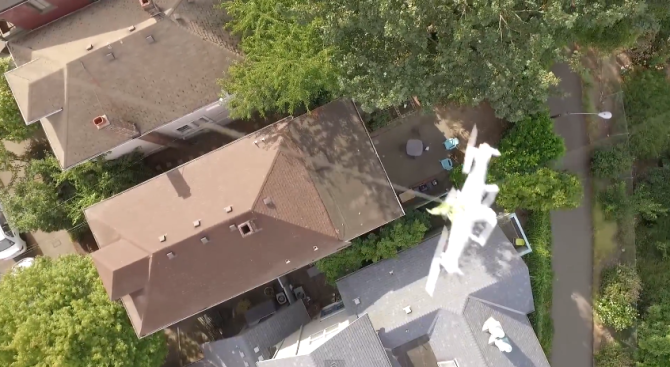 Guy Uses New Drone to Rescue Lost Drone from Neighbor's Roof