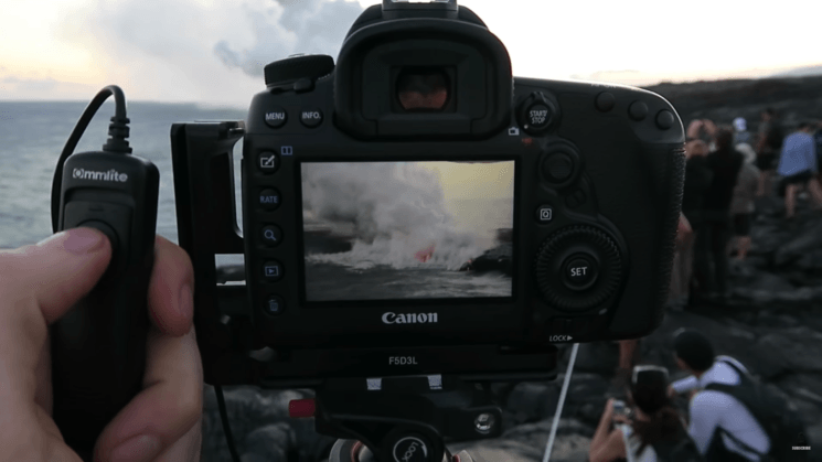 Photographer tells off tourists who block his view while photographing an active volcano