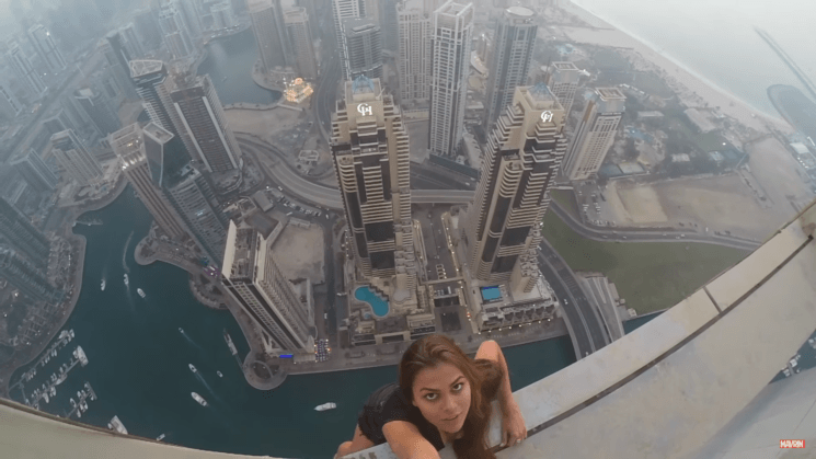 This model dangled over a 1000 ft skyscraper for a photo without safety equipment